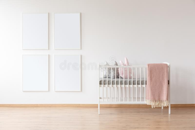 White crib and poster mockups stock photo