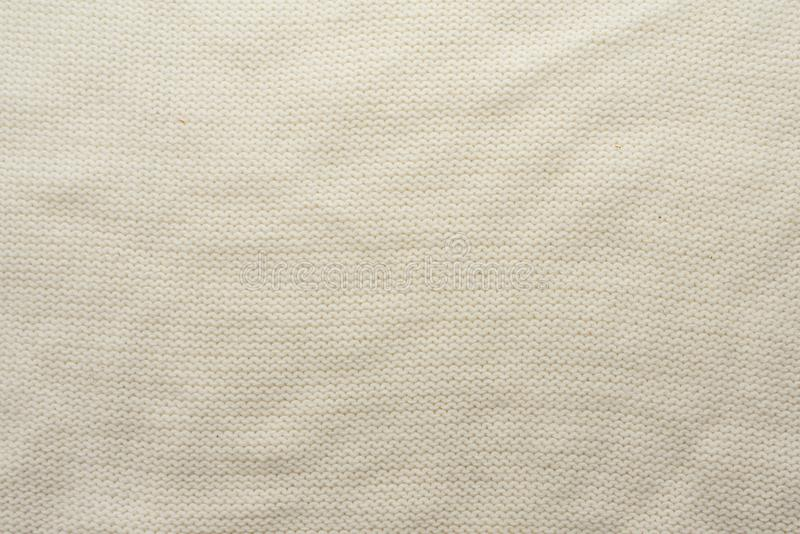 White crocheted fabric texture, crumpled. Design concept stock image
