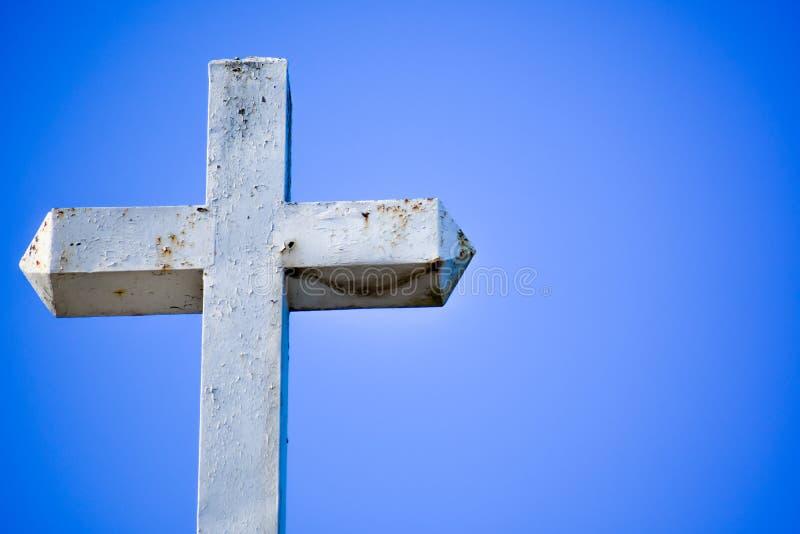 White Cross Against Blue Sky royalty free stock image