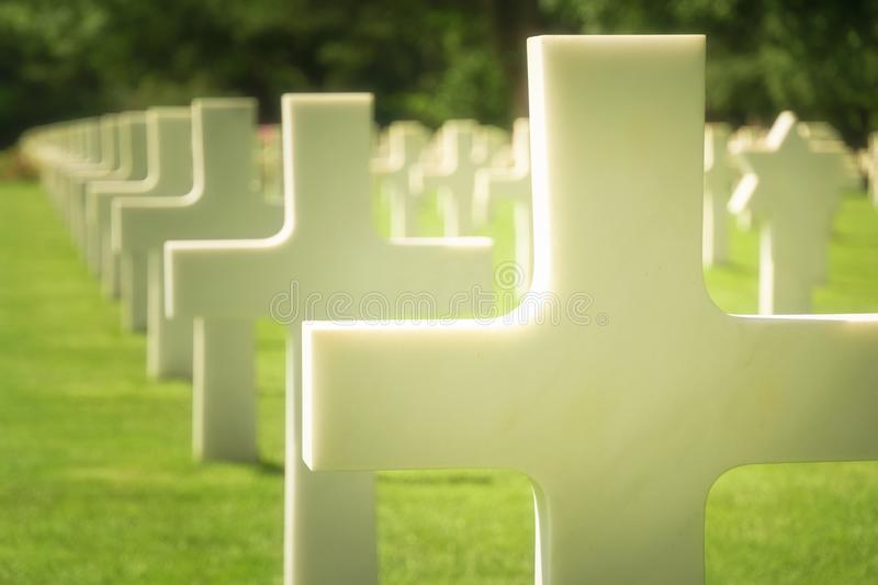White cross grave closeup, Normandy American Cemetery, France. Selective focus. White cross grave closeup, US military graveyard, Normandy American Cemetery royalty free stock image