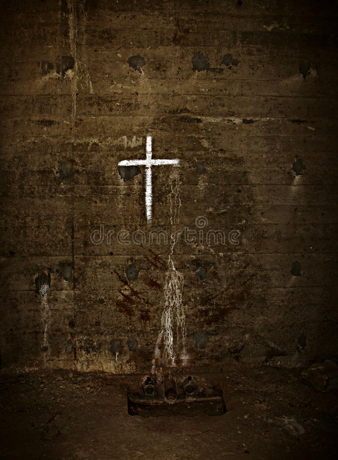 White Cross Grunge. A spray-painted crucifix on a wall in Lebanon. Grungy feel royalty free stock photography