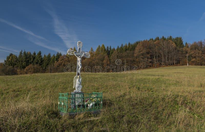 White crucifix near path from Zitkova village in autumn morning. Crucifix near path from Zitkova village in autumn morning royalty free stock images