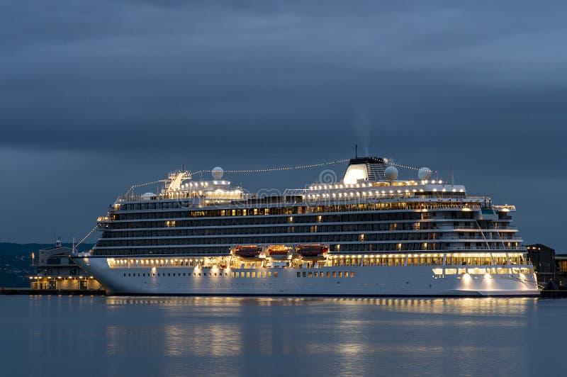 White cruise ship illuminated in the night. royalty free stock image