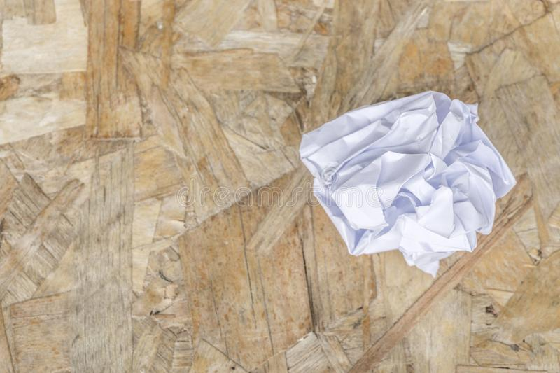 White Crumple paper ball on old wood table. Copy space royalty free stock images