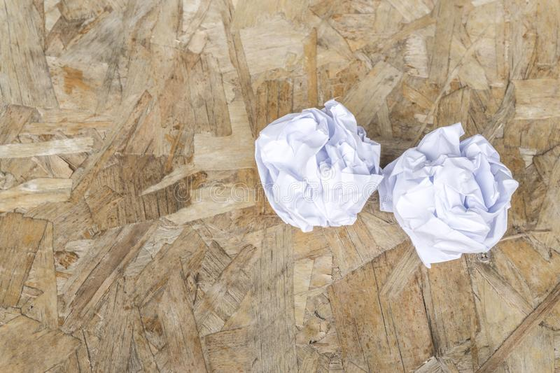 White Crumple paper ball on old wood table. Copy space royalty free stock photos