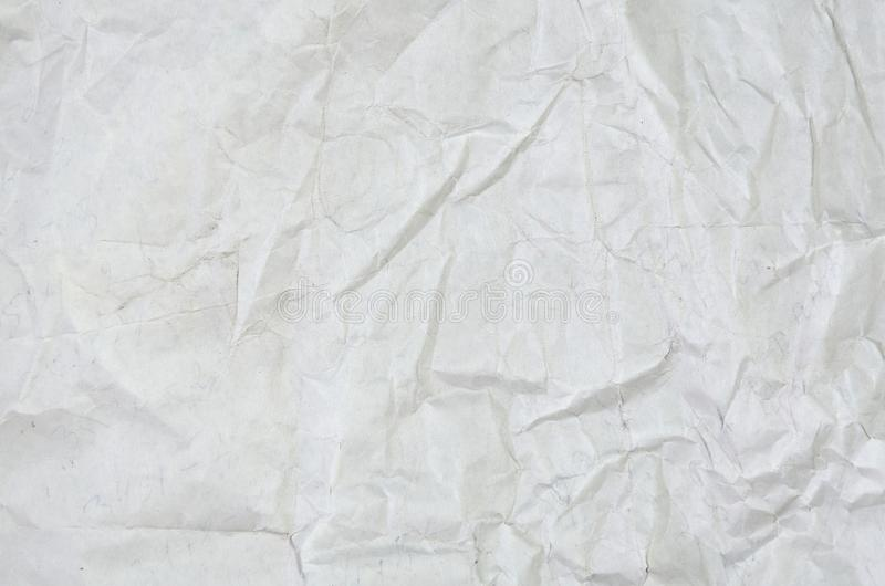 White crumpled paper blank background surface. Pastels book cover paint top view. Gray grunge surface empty parchment sheet. Art poster above folds angle craft royalty free stock photography