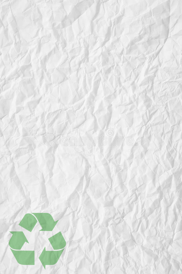 White crumpled paper and recycling sign. Texture of white crumpled paper and green recycling sign stock images