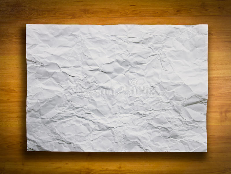 White Crumpled Paper on Wood Background. White Crumpled Paper on the Wood Background royalty free stock photo