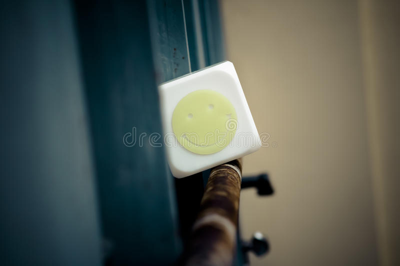 White cube with a smiling face emoticon royalty free stock photography