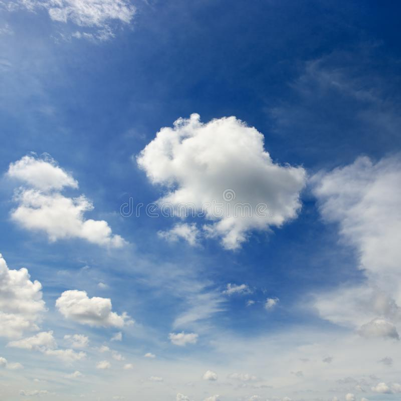 White cumulus clouds against the background of an epic blue sky. royalty free stock photo