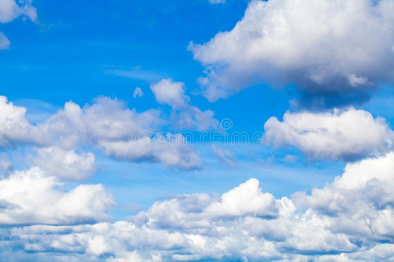 White cumulus clouds in blue sky. At daytime. Natural background photo texture stock photography