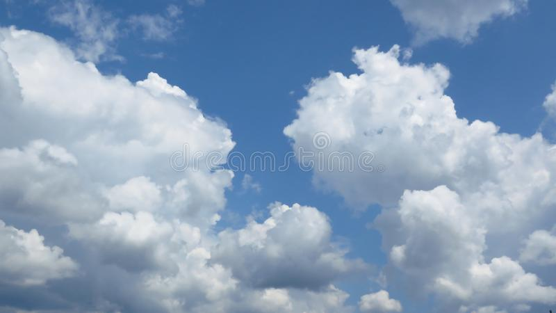Beautiful white cumulus clouds in the blue sky. Weather forecast concept. Oxygen, environment. Beautiful white cumulus clouds in the blue sky. Rounded, puffy stock photography