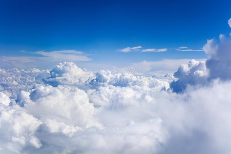 White cumulus clouds on clear blue sky background closeup, overcast skies backdrop, fluffy cloud texture, beautiful cloudscape royalty free stock photo