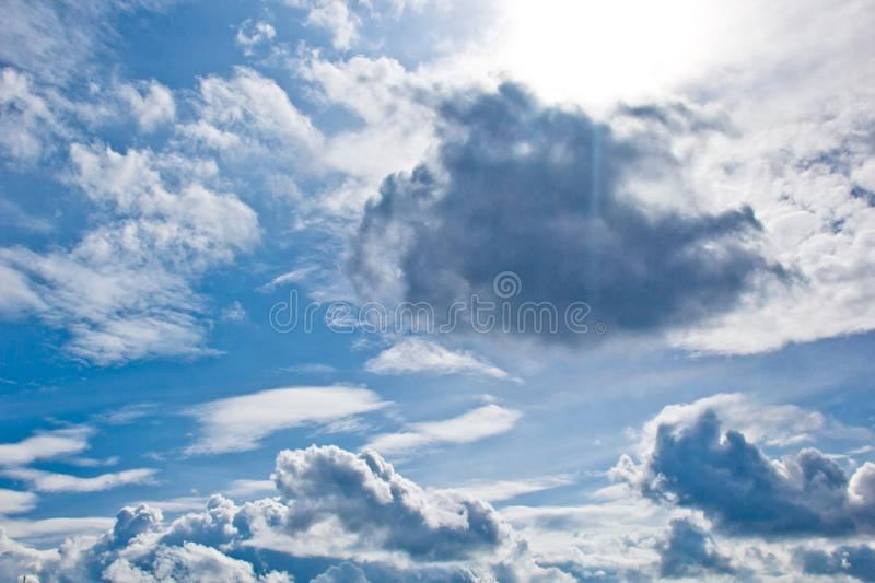 White cumulus clouds in the form of cotton wool on a blue sky. background, bright sky texture.  stock photography