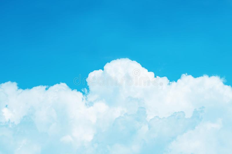 White cumulus clouds against a bright azure sky background, ton stock photography