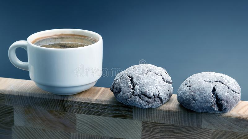 White Cup of black coffee with biscuits on a wooden frame royalty free stock photo