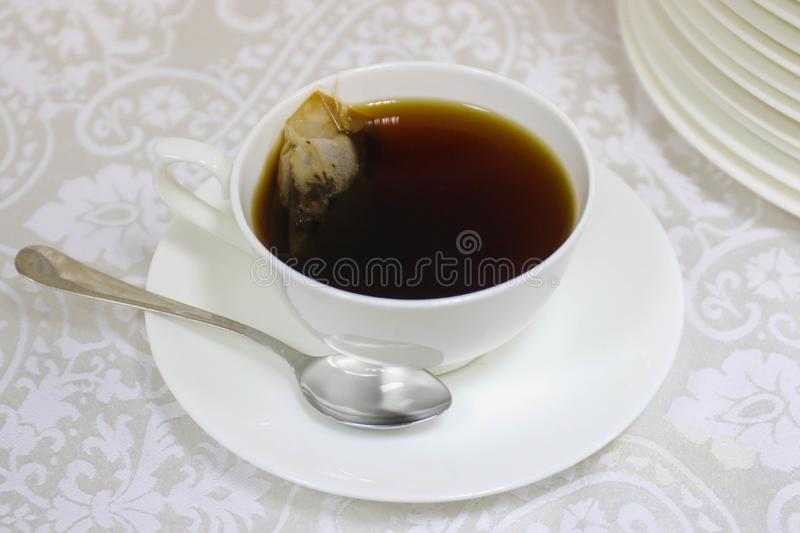 White cup with black tea royalty free stock photos