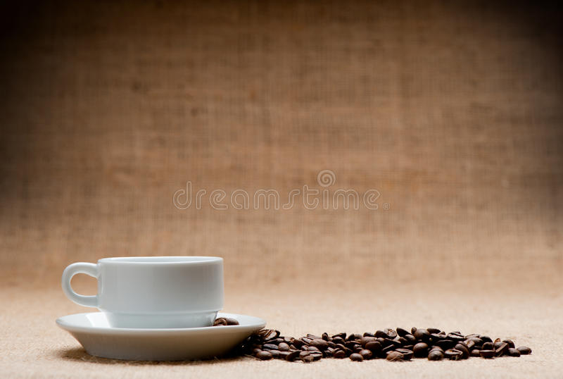 White cup c grains of coffee royalty free stock photography