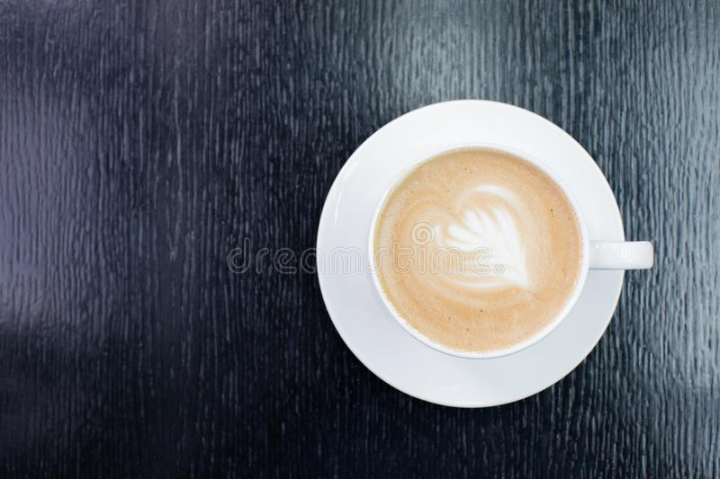 White Cup of cappuccino coffee with foam on the table in a cafe or restaurant stock images