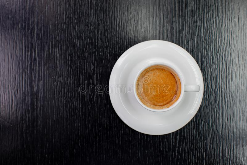 White Cup of cappuccino coffee on the table in restaurant stock image