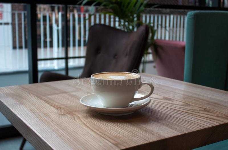 White cup of cappuccino stock photo