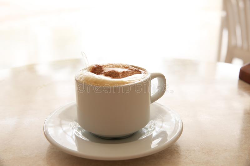 Cup of cappuccino on the table stock photo