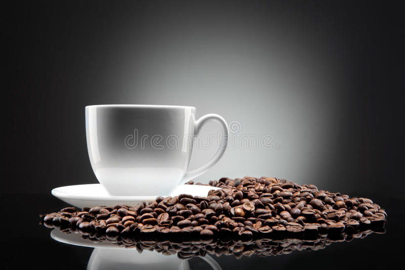Download White Cup With Coffee Beans On Black Stock Photo - Image of fried, natural: 18930098