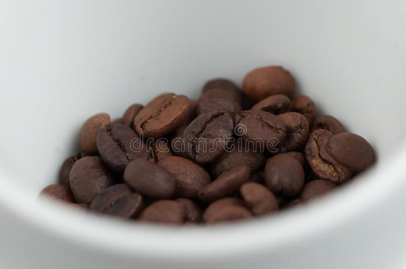 White cup of coffee and coffee beans isolated on black background. Brown, drink, morning, cafe, breakfast, caffeine, dark, espresso, food, roasted, mocha stock images