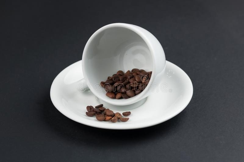 White cup of coffee and coffee beans isolated on black background. Brown, drink, morning, cafe, breakfast, caffeine, dark, espresso, food, roasted, mocha royalty free stock photography