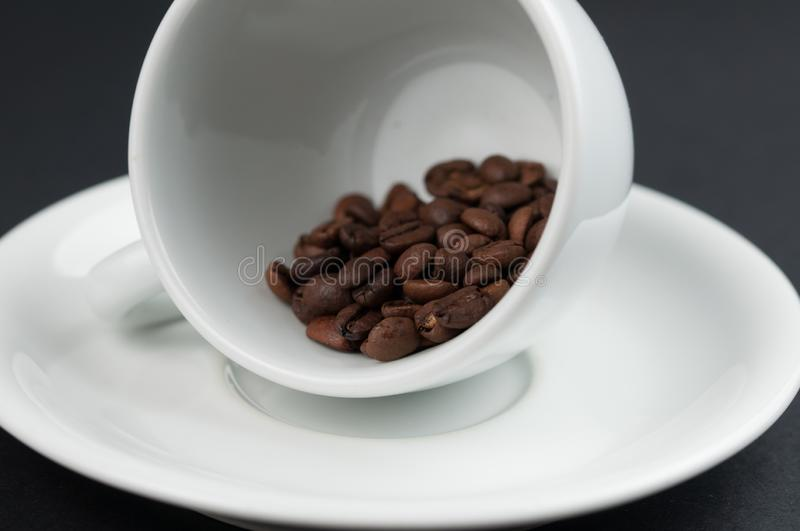 White cup of coffee and coffee beans isolated on black background. Brown, drink, morning, cafe, breakfast, caffeine, dark, espresso, food, roasted, mocha royalty free stock image