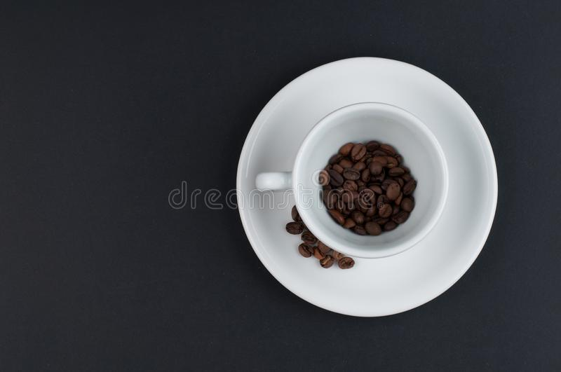 White cup of coffee and coffee beans isolated on black background. Brown, drink, morning, cafe, breakfast, caffeine, dark, espresso, food, roasted, mocha royalty free stock photo