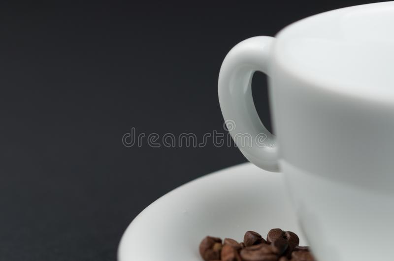 White cup of coffee and coffee beans isolated on black background. Brown, drink, morning, cafe, breakfast, caffeine, dark, espresso, food, roasted, mocha stock photos