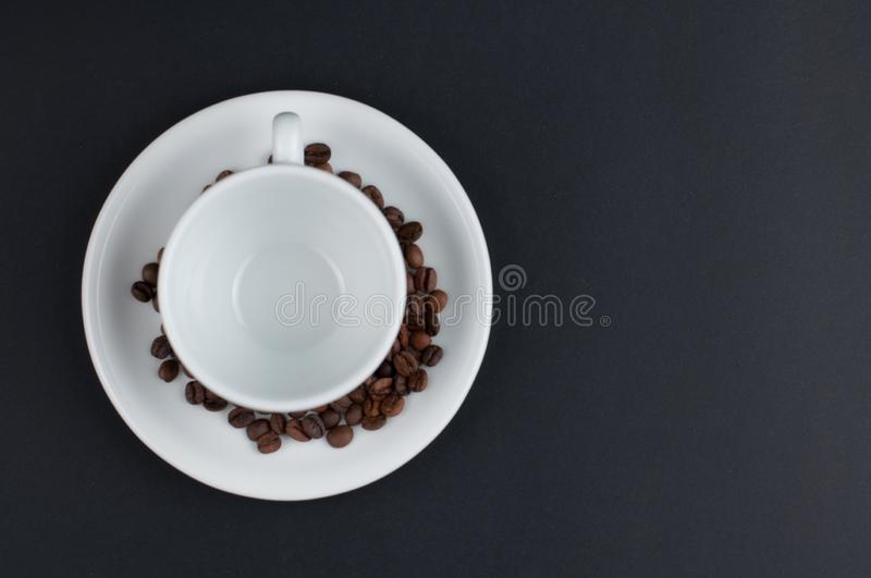 White cup of coffee and coffee beans isolated on black background. Brown, drink, morning, cafe, breakfast, caffeine, dark, espresso, food, roasted, mocha royalty free stock photos