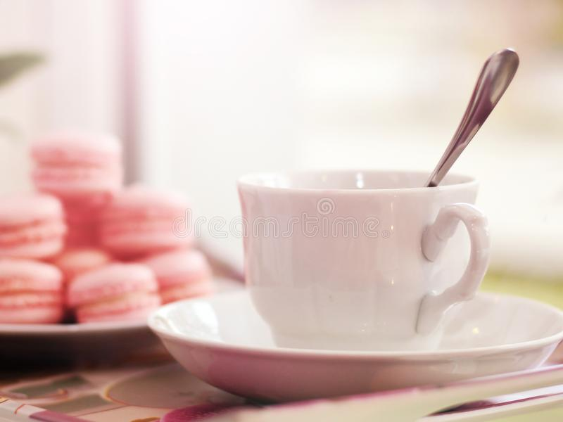 White Cup of coffee in a cafe, macaroons royalty free stock images