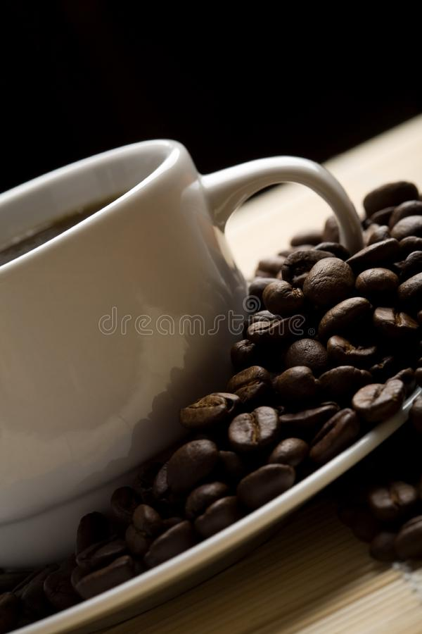 White cup of coffee and coffee beans stock image