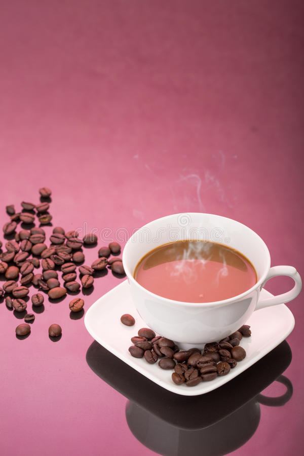 White cup of coffee and coffee beans royalty free stock photo