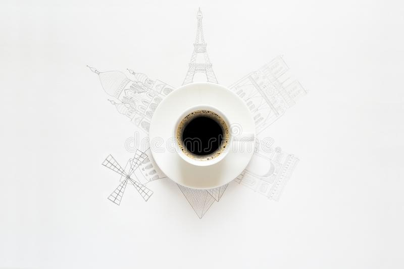 White cup of coffee and Paris attractions sketches around. Pencil drawing. Top view stock photo