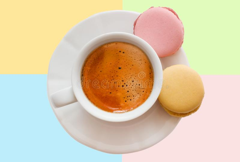 White cup of espresso coffee with colourful french macarons top view on colorful background, Good morning or have a nice day royalty free stock photos
