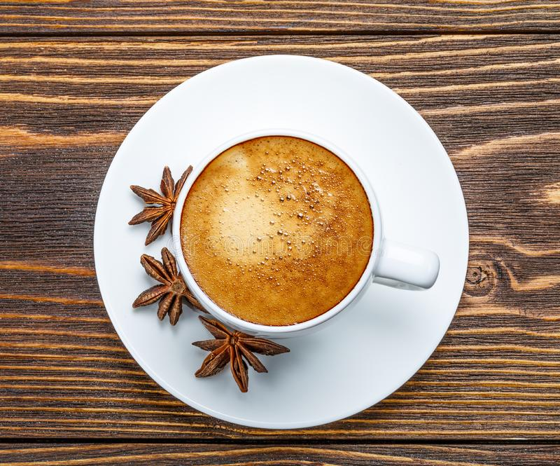 White cup of espresso on a wooden background stock photo