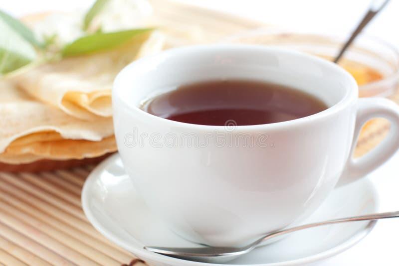 White cup of fragrant tea stock photos
