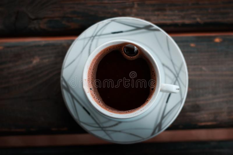White Cup on Saucer on Brown Wooden Table stock images