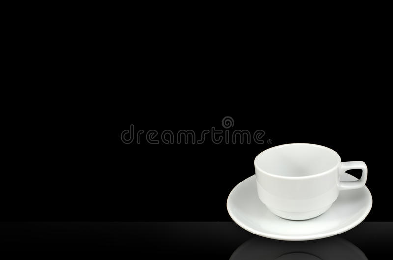 White Cup And Saucer Isolated On Black Background Stock Images