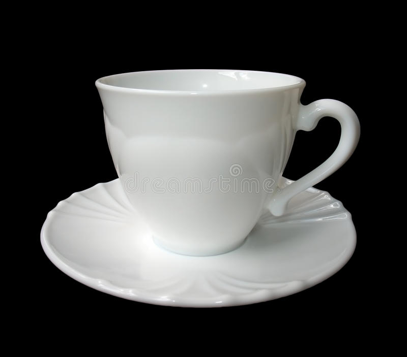 White cup on a saucer isolated on black background stock photography