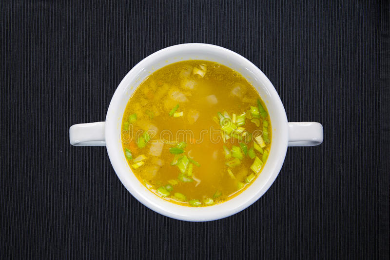 White cup with soup royalty free stock photos