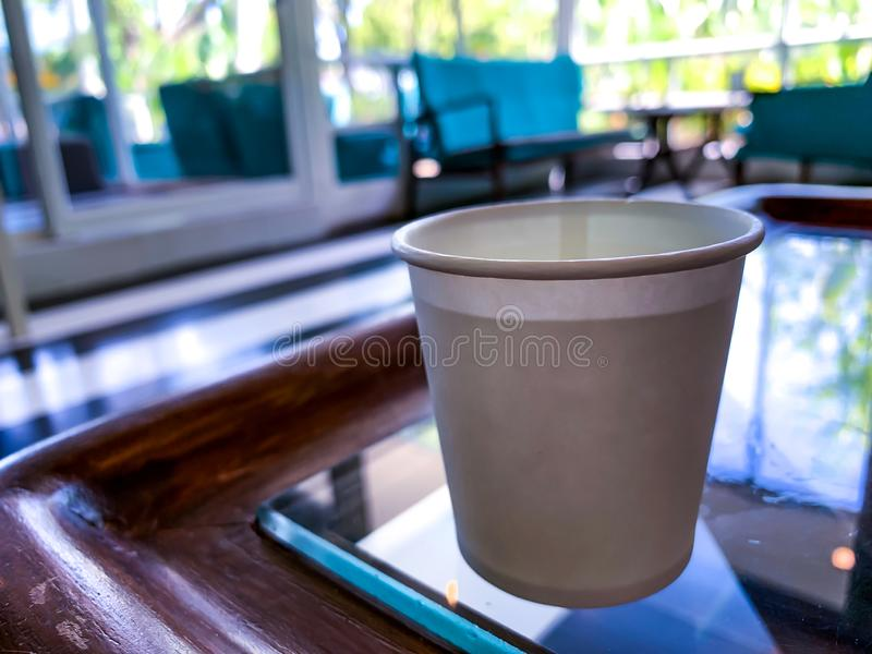 White cup on the table in the coffee shop stock photography