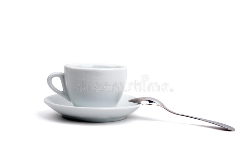 White cup of tea on a white background stock image