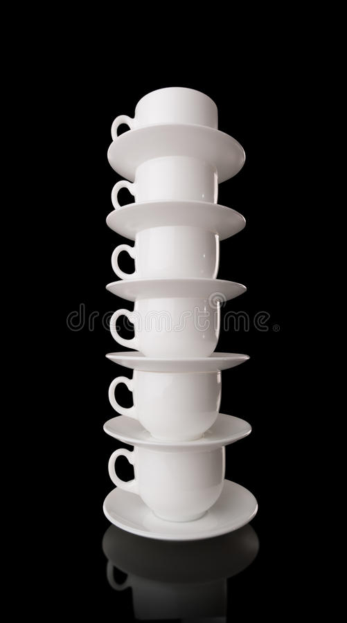 Download White Cups And Saucers On A Black Background Stock Image - Image: 23665665