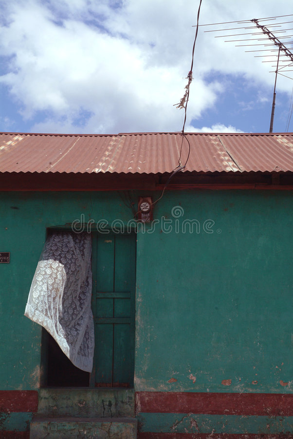 Download White Curtain Blows From Door Of Green House With Antenna Stock Image - Image: 835051