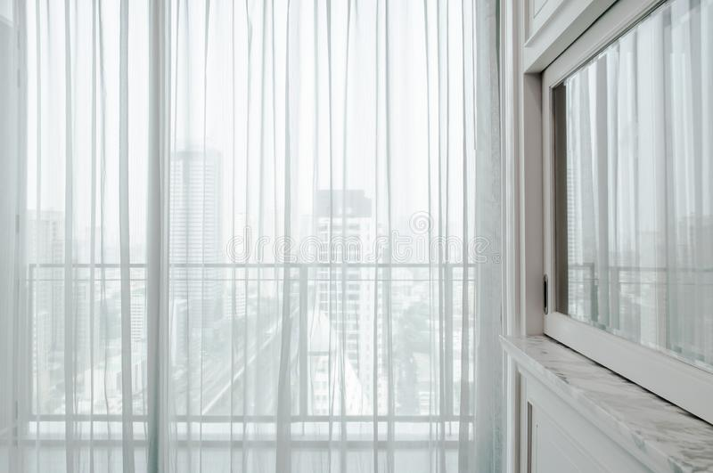 White curtain sunlight through the windows in the city. Design linen fabric and pattern or background royalty free stock photography