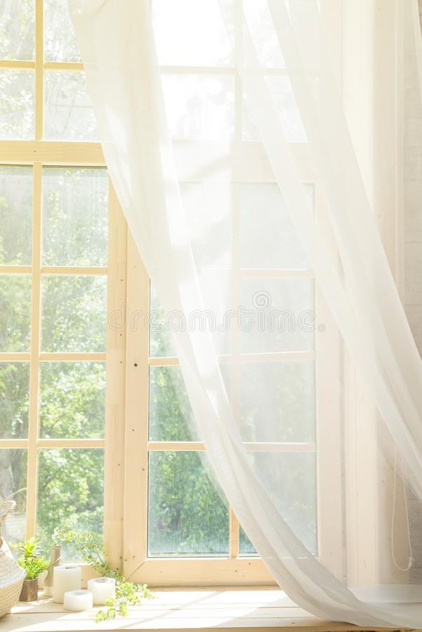 White Curtain and Wood Window Frame High key Background with sunlight. Interior design with wooden window with white curtain and garden view. High key Background stock photos